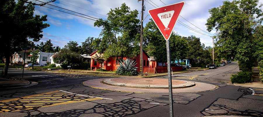 A Yield sign on a street.