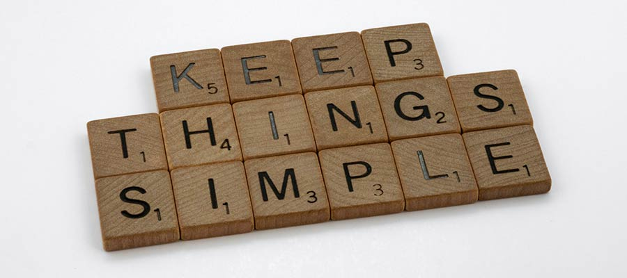 """Letter tiles that spell out """"KEEP THINGS SIMPLE""""."""